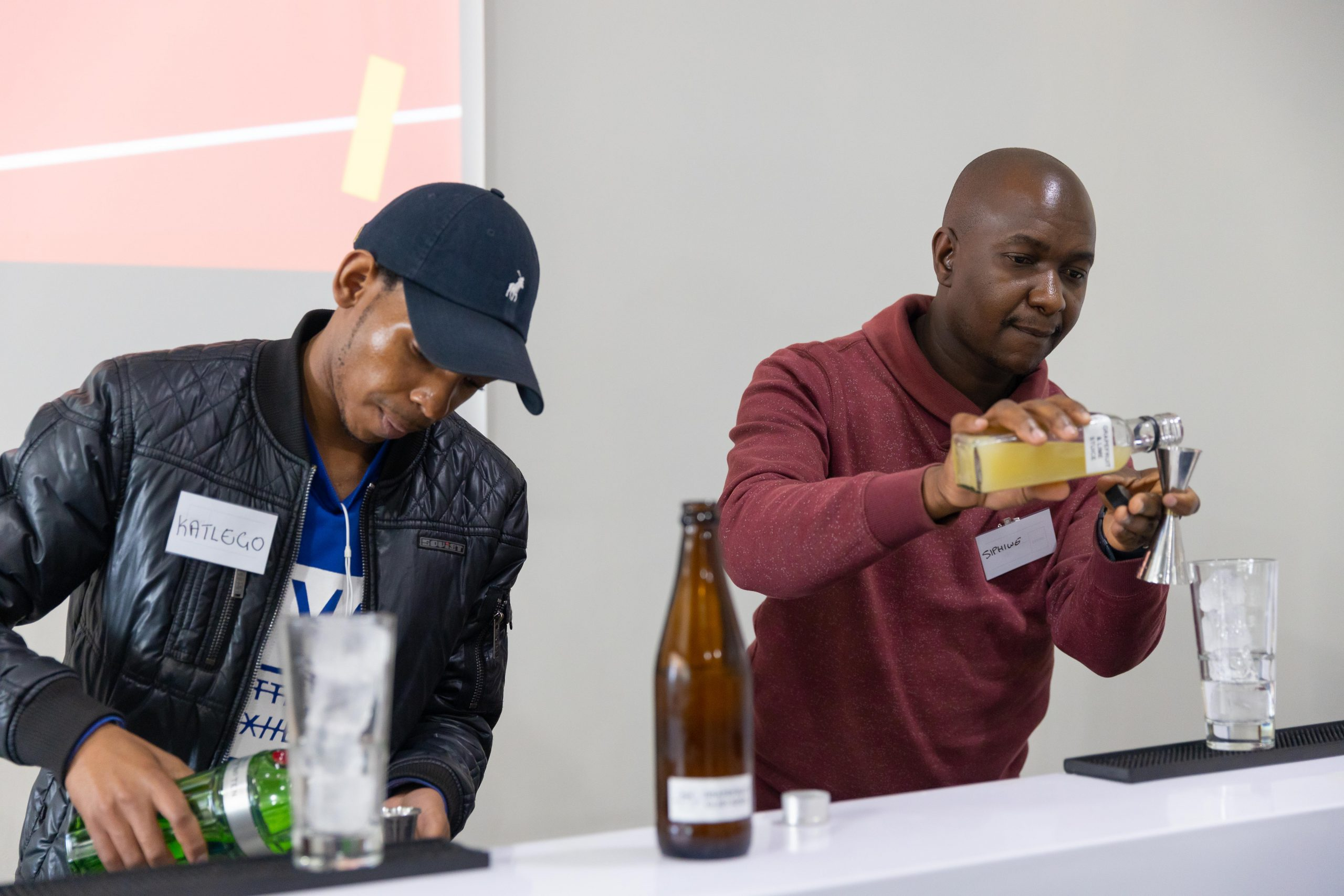 Diageo SA - Katlego Tlhatlhedi, from Roodepoort & Siphiwe Ngcobo, from Ekurhuleni, two mentees at the first Mentorship Training session in JHB showcasing their bartending skills